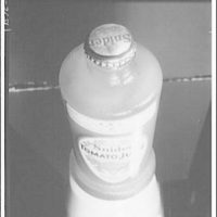 Closures on bottles and jars for glass containers. Tomato juice in glass bottle with cap I
