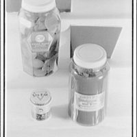 Closures on bottles and jars. Two large jars and one small jar