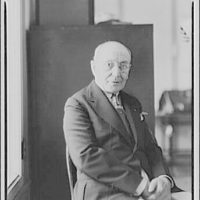 Colonel Schloss. Seated three-quarter portrait to left of Colonel Schloss