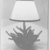 Connoisseur Antiques, 1516 Wisconsin Ave., N.W. Planter lamp, with pine cones and branches