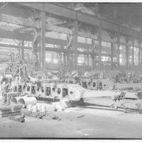 Construction of a railroad engine. Erection of locomotive framework