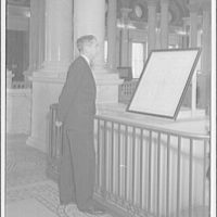 Democratic Digest. Attorney General Tom Clark looking at Bill of Rights II