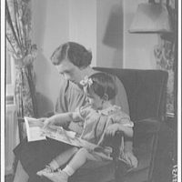 Dr. Joseph Quincy Adams, first director of the Folger Library. Mrs. Adams and her little girl I