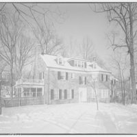 Dr. Pucki's home in Wesley Heights. Exterior of Dr. Pucki's house in snow I
