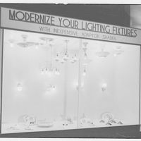 "Electric Institute of Washington, Potomac Electric Power Co. Building. Case display with slogan ""Modernize your lighting fixtures"""