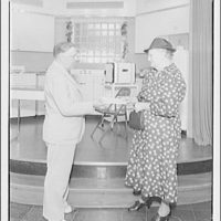 Electric Institute of Washington, Potomac Electric Power Co. Building. Mrs. L.A. Stone receiving check from the Electric Institute