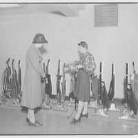 Electric Institute of Washington, Potomac Electric Power Co. Vacuum cleaners display with people