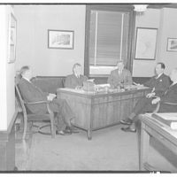 Electric Institute of Washington snap shots for movies and films. Five men around desk in office I