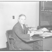 Electric Institute of Washington snap shots for movies and films. Man at desk