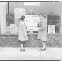 Electric Institute of Washington snap shots for movies and films. Two women in front of street window display