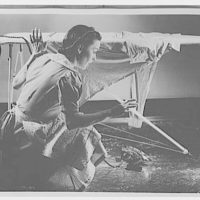 Electric Institute of Washington. Woman at ironing board with fallen iron