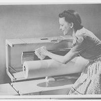 Electric Institute of Washington. Woman cleaning ironing machine