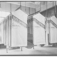 Elite Laundry. Hanging rows of wrapped drycleaning