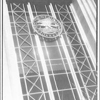 Emblems and seals. Metal emblem over door of Department of Justice