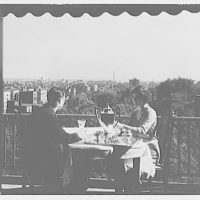 Envoy, formerly Meridian Mansions, 2400 16th St. Couple at table on balcony of Meridian Mansions I