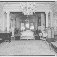 Fairmount School, 1711 Massachusetts Ave. Room at Fairmount School with piano, patterned wallpaper and chandelier