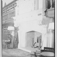 Folger Library interiors. Mrs. Folger standing by fireplace in reading room I