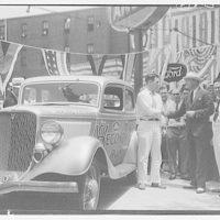 Ford V-8 economy run. Senator Reynolds congratulating driver Parker Lewis of AAA II