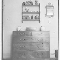 Furniture and other home furnishings. Bureau with masking against brick backdrop