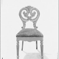 Furniture and other home furnishings. Carved wood chair with upholstered seat