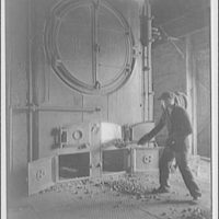 Gas plant. Stocking a furnace, Alexandria City