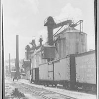 Glass factory in Jeannette, Pennsylvania. Exterior of glass factory with boxcars