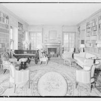 Harriman house. Interior of Harriman house with bookshelves and piano