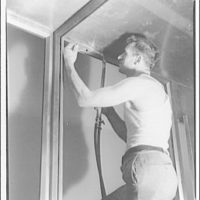 International Nickel Co. at Walter Reed Hospital. Man soldering in nickel room, Walter Reed Hospital