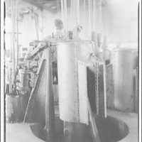 Lennox Furnace Co. Riveting a steel furnace