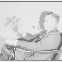 Lt. Williams. Lt. Williams with model airplane III