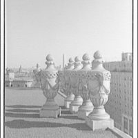 Mayflower Hotel. Decorative stone urns on roof of Mayflower Hotel