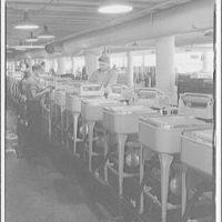 Maytag Washing Machine Company. Line of Maytag washers