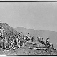 Military subjects. Soldiers building road in mountains