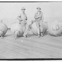 Military subjects. Soldiers on ship with mines
