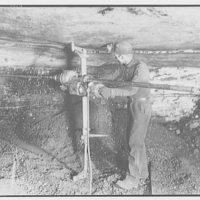Mining. Man using drill in mine