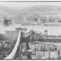 Mining. Mine above ground showing mining facilities, rail cars and river