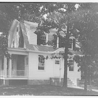 Miscellaneous houses. Two-story house with white side boarding and porch on left side