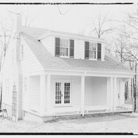 Miscellaneous houses. Two-story house with white side boarding with porch