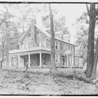 Miscellaneous houses. Two-story stone house with side porch