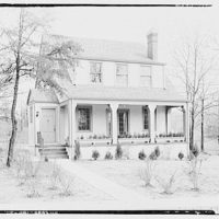 Miscellaneous houses. Two-story stucco house with porch and entrance on left side