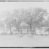 Miscellaneous houses. Two-story white house with pedimented porch in trees