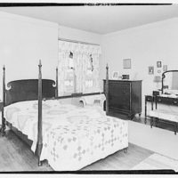 Miscellaneous interiors. Bedroom with bed with quilted spread
