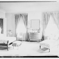 Miscellaneous interiors. Bedroom with double bed, to windows