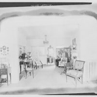 Miscellaneous interiors. Interior through square archway to curtained door
