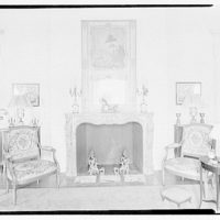Miscellaneous interiors. Interior, to fireplace borderd by chairs with patterned upholstery I