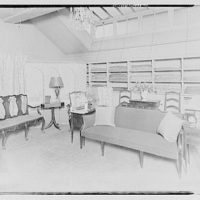 Miscellaneous interiors. Interior with two couches, shelves and windows at ceiling