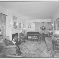 Miscellaneous interiors. Living room, to piano with man reading