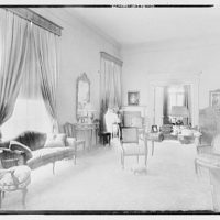 Miscellaneous interiors. Living room with chair in middle, to entry