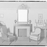 Miscellaneous interiors. Living room with firepalce and mirror bordered by two chairs