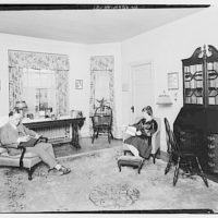 Miscellaneous interiors. Man and woman reading in living room